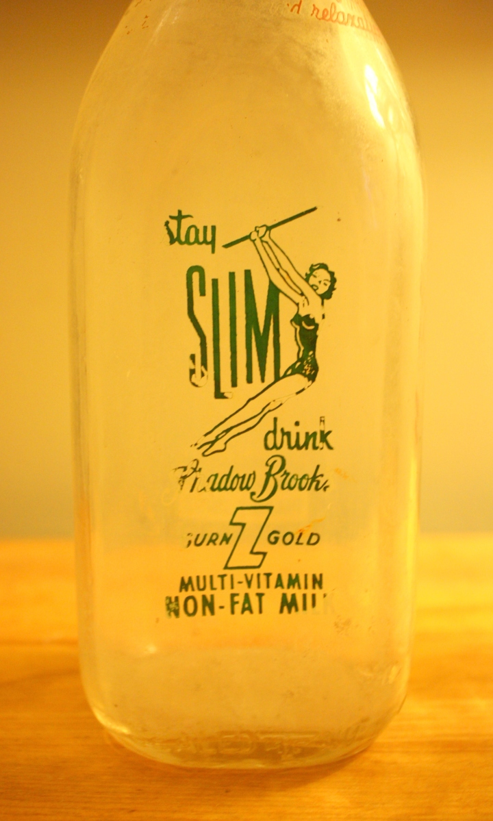 Antique Milk Bottles Vibrant Graphics And Catchy Slogans