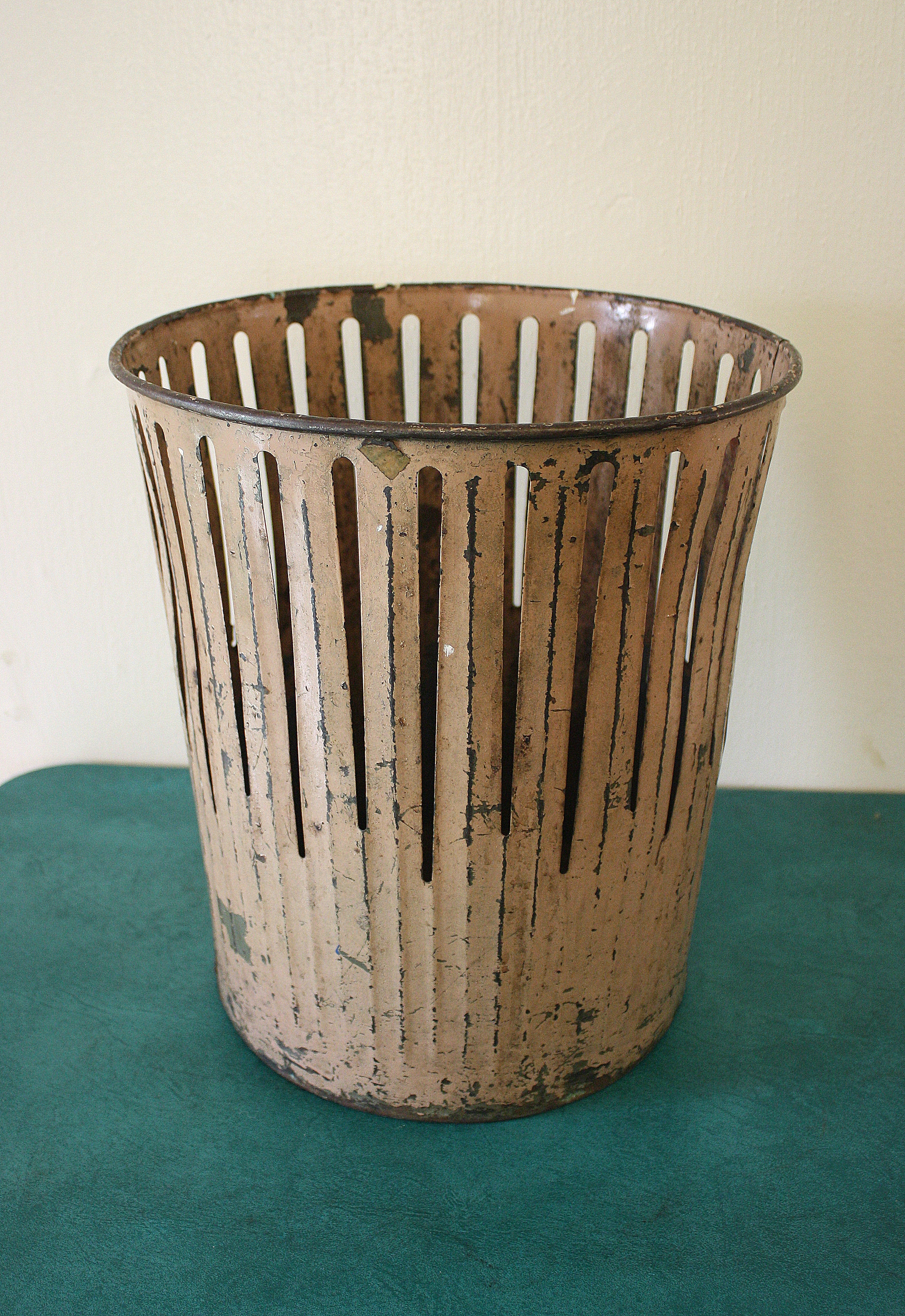 Antique trash can slatted
