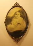 Antique Victorian child in a bubble glass wood frame