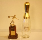 Vintage bowling trophy with Beam's pin liquor decanter