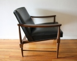 mid century modern chair with sculpted back detail 2