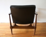 mid century modern chair with sculpted back detail 3