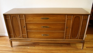 mcm credenza oval sculpted doors 1