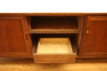Middle compartment with sliding door and bottom drawer