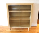 Mid century modern mini blonde bookcase with glass doors