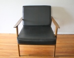 mcm arm chair with black naugahyde cushions 1