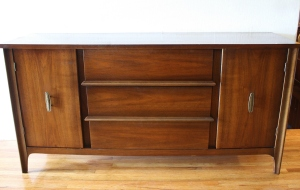 mcm credenza with brass handles and streamlined drawers 1