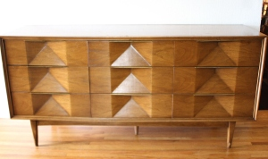 mcm sculpted low dresser with angled concave design 1