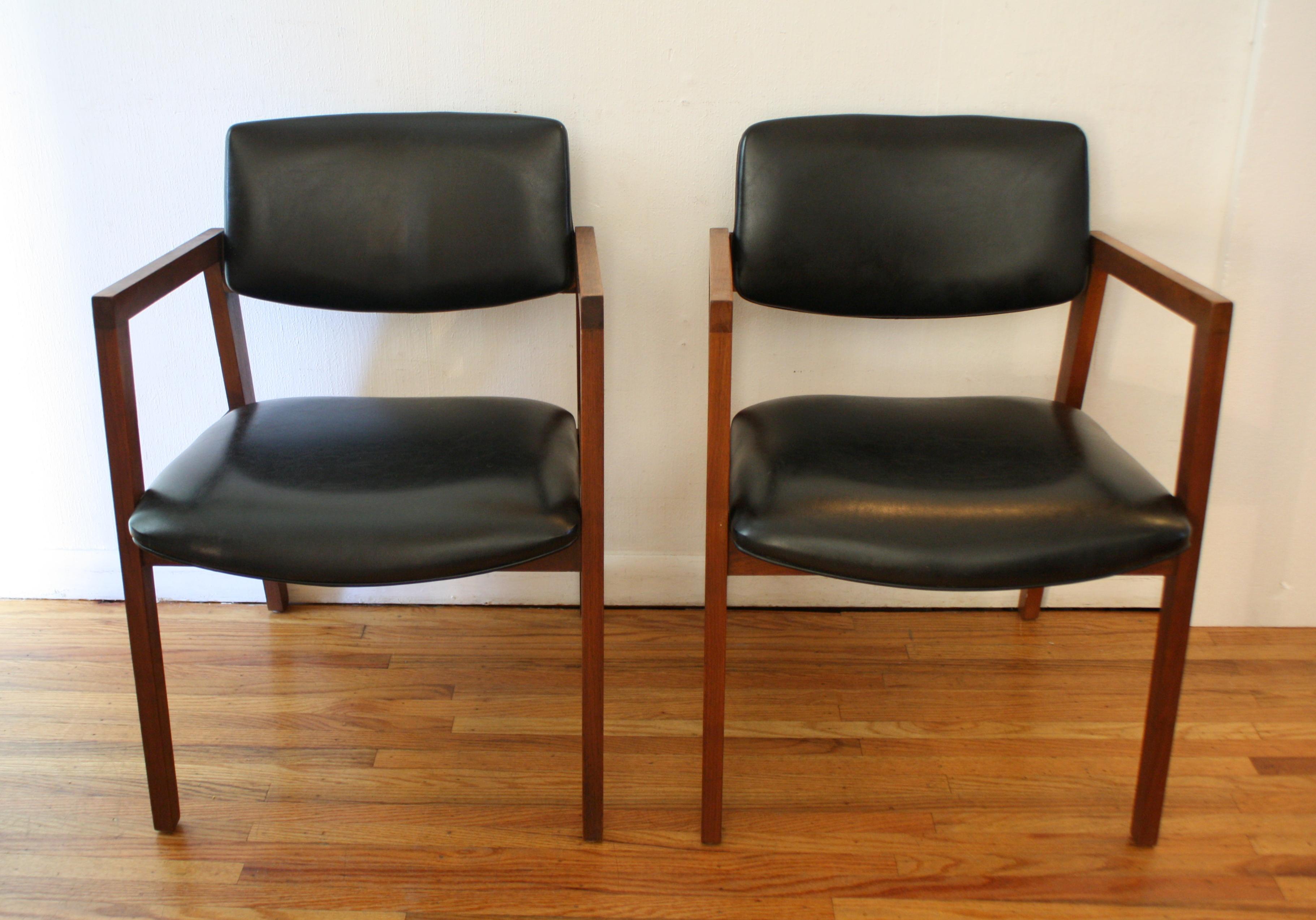 mcm pair of black naugahyde chairs 1