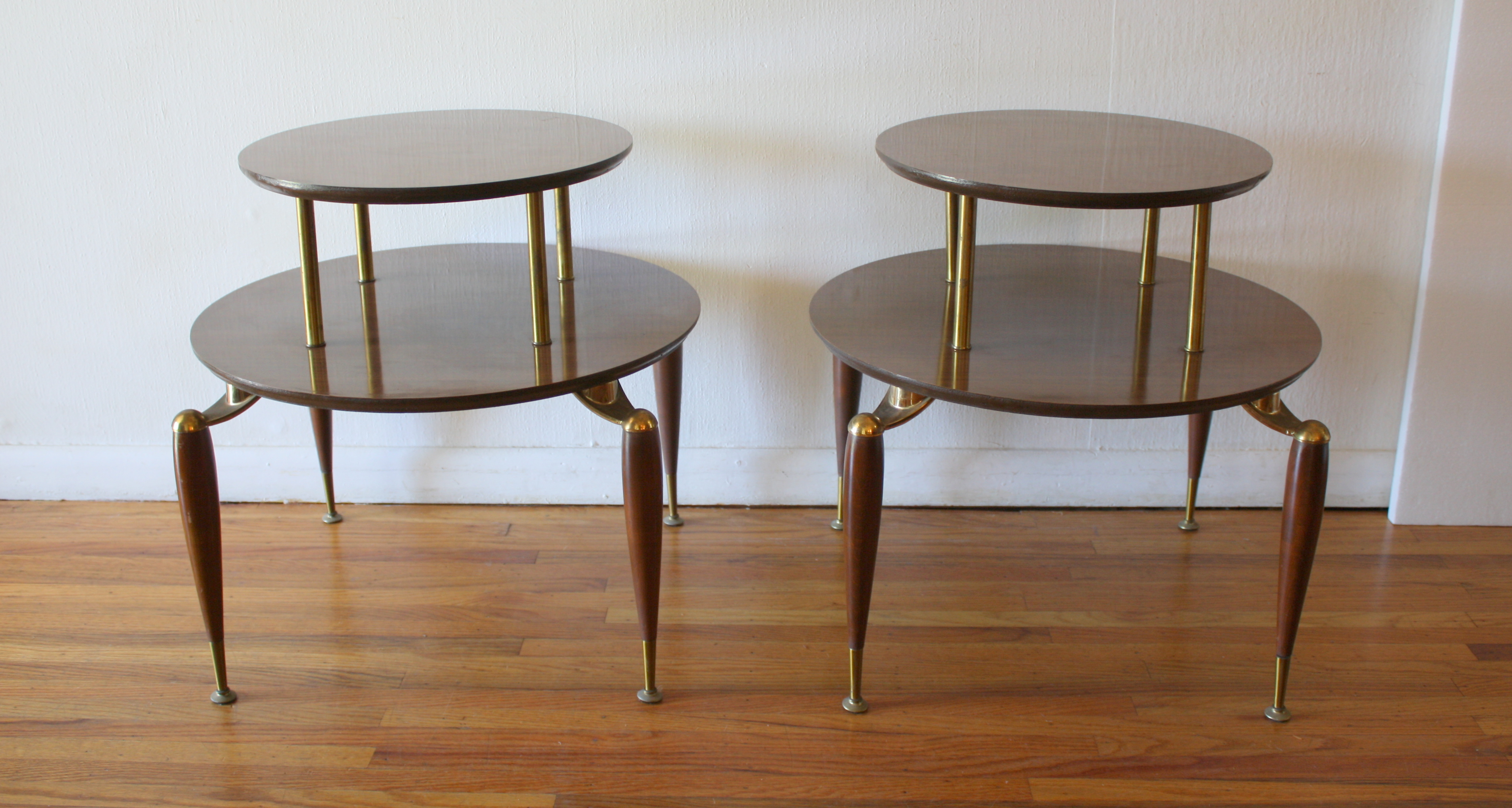 mcm pair of round 2 tiered side tables 2.JPG