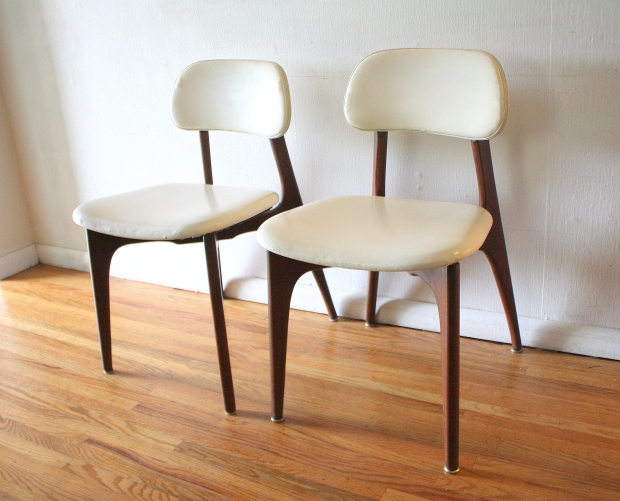 mcm pair of white naugahyde chairs with sculpted backs 1