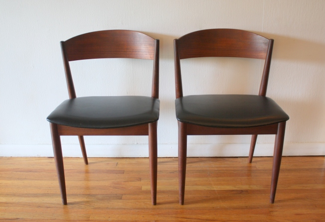 mcm pair of black naugahyde chairs 1