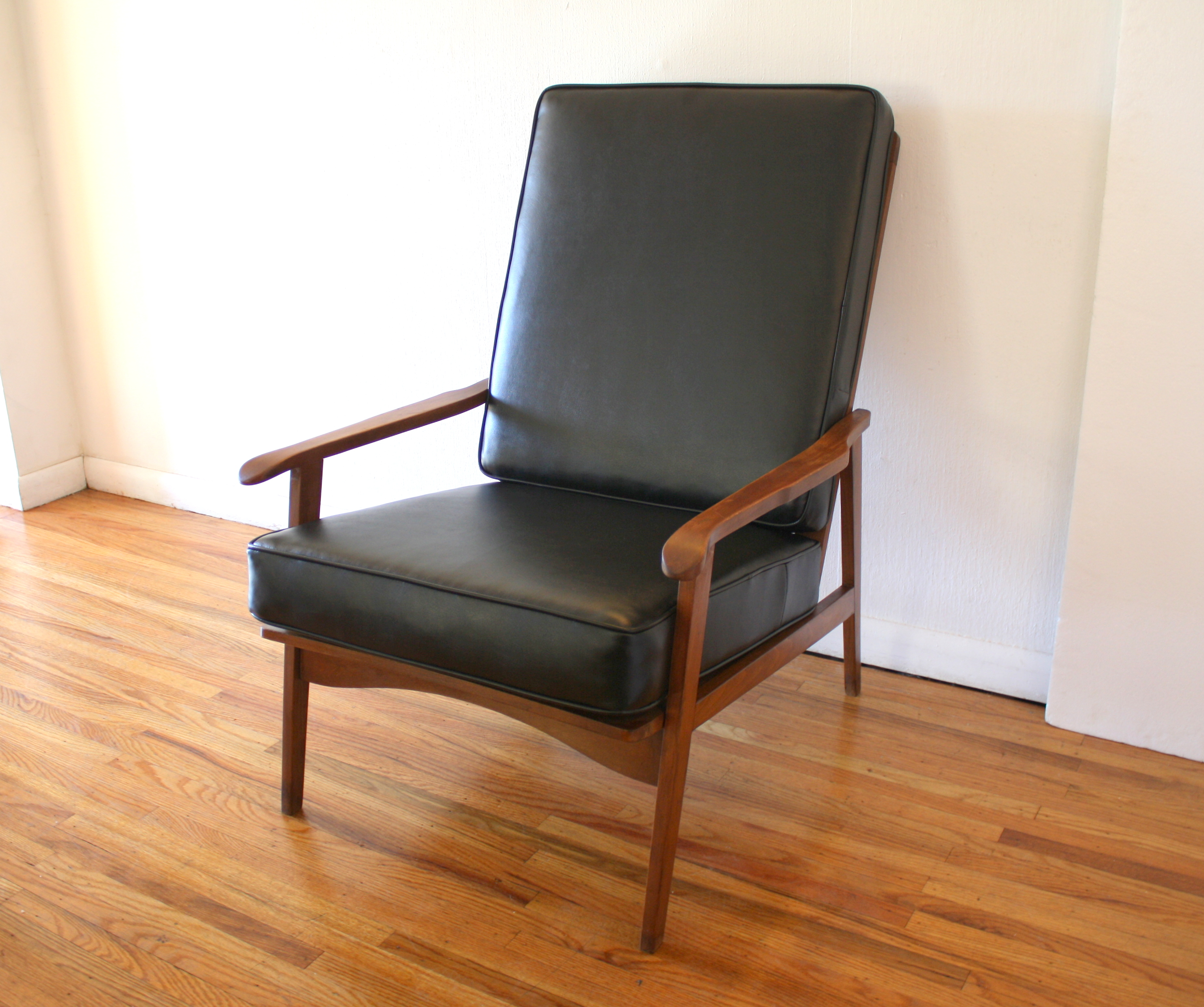 mcm arm lounge chair with black naugahyde 1.JPG