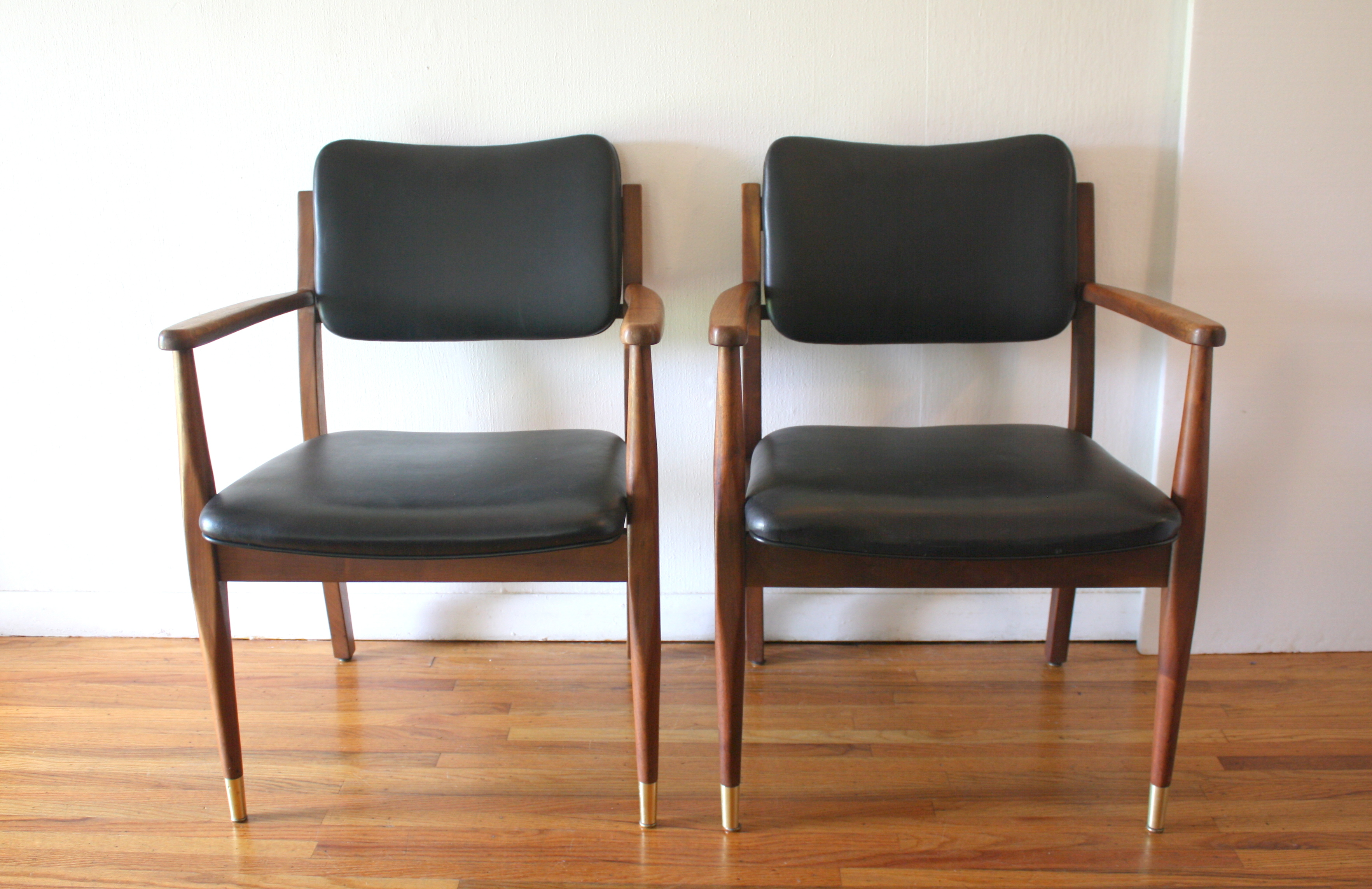 mcm pair of black naugahyde Gregson chairs 1