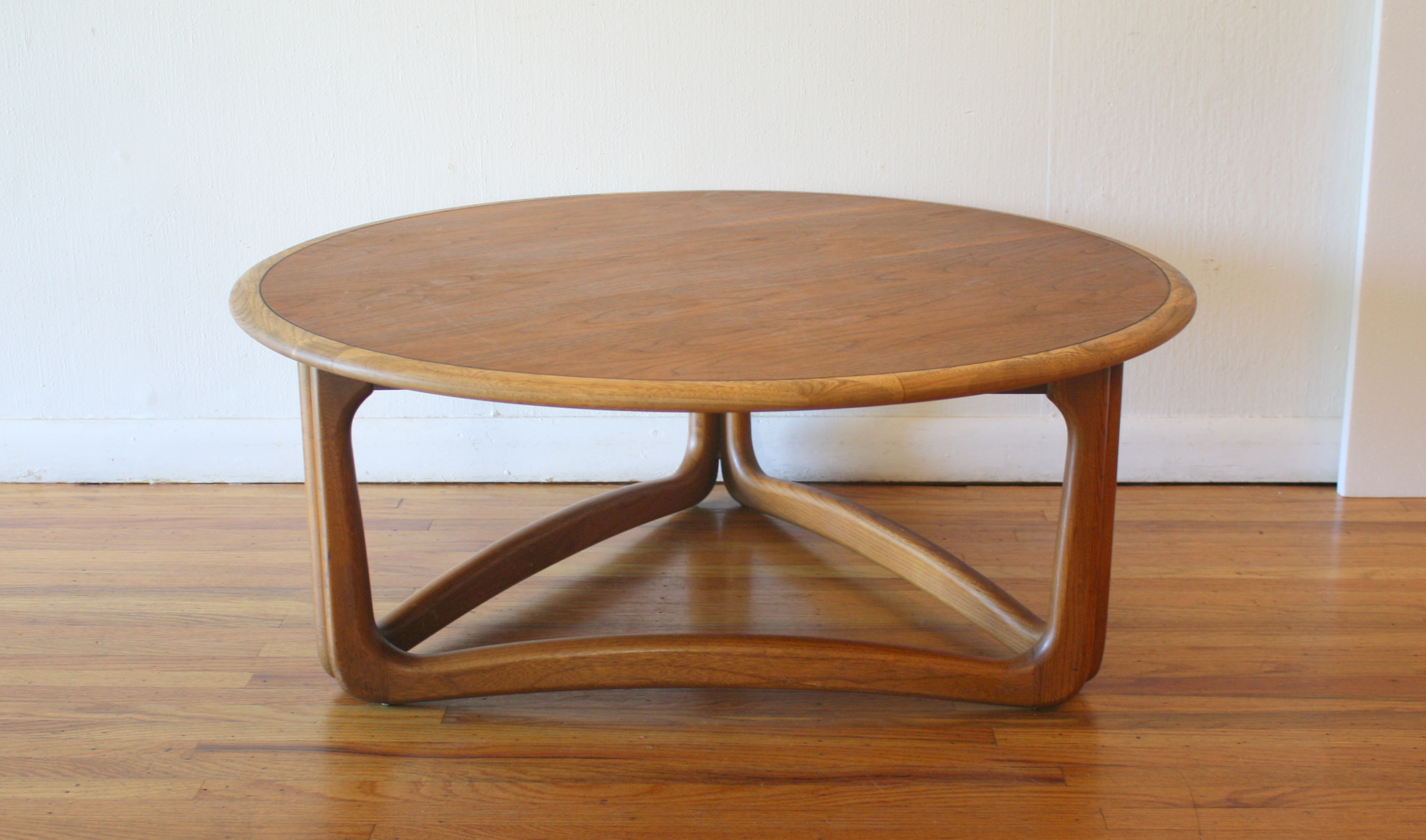 Lane round coffee table sculpted base 1.JPG