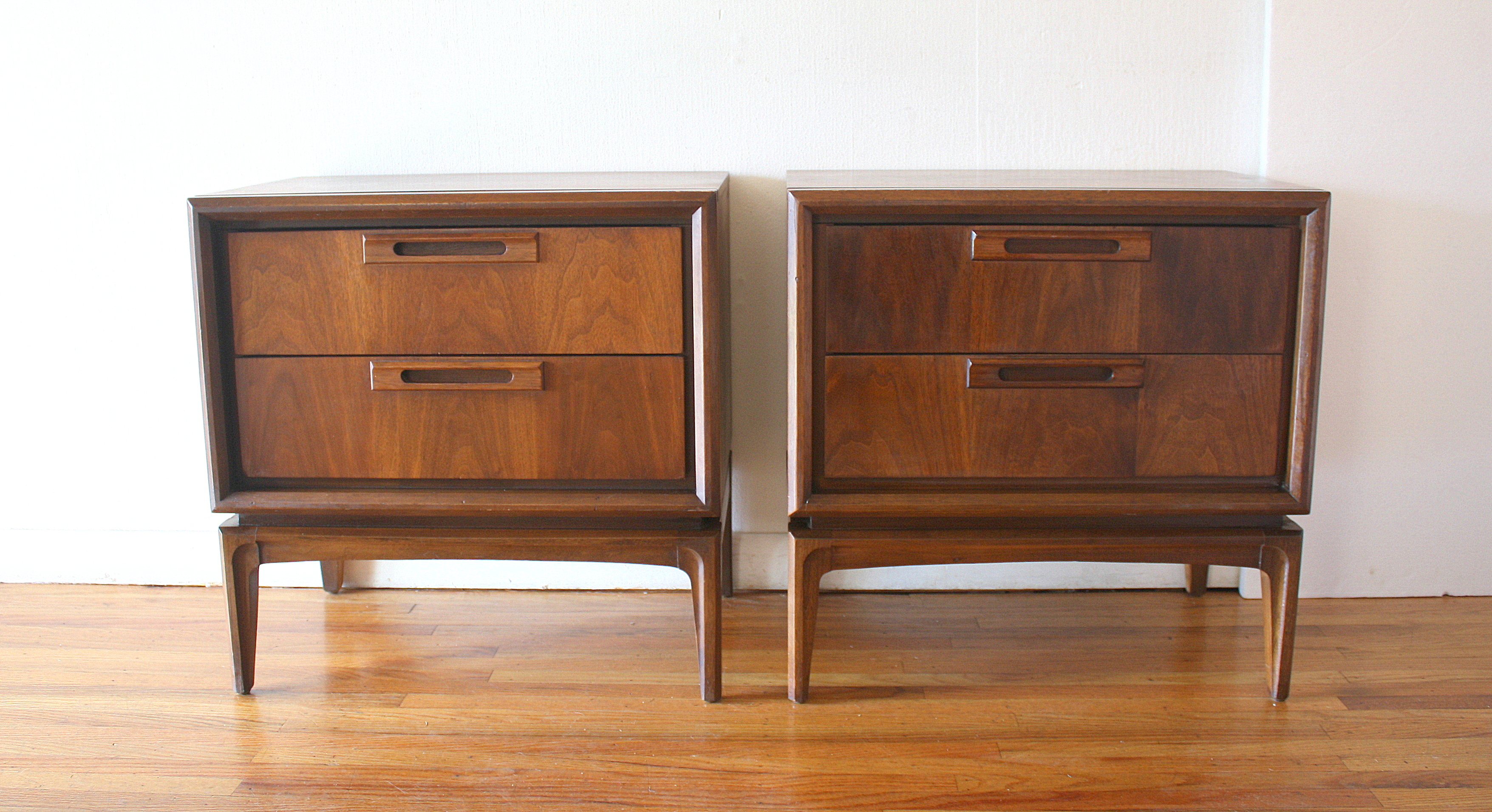 mcm pair of nightstands with wood pulls 1