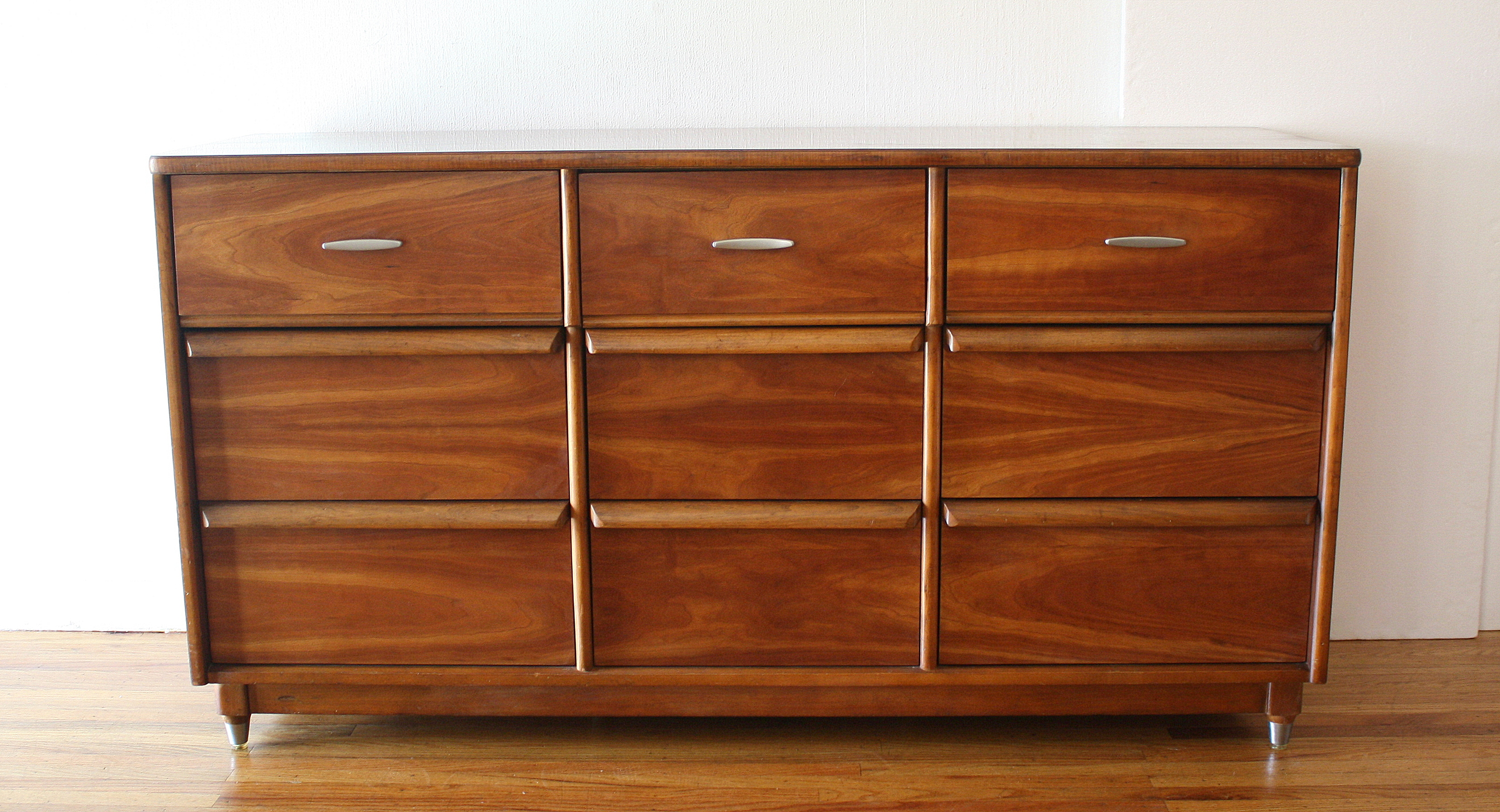mcm low dresser with lucite tipped tapered legs 1.JPG