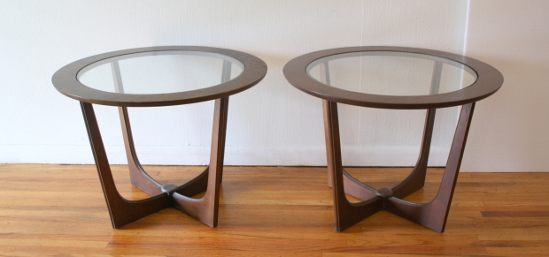 pair of Bassett round glass topped side tables 1