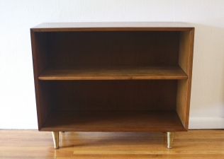 Mcm bookshelf with brass legs 1