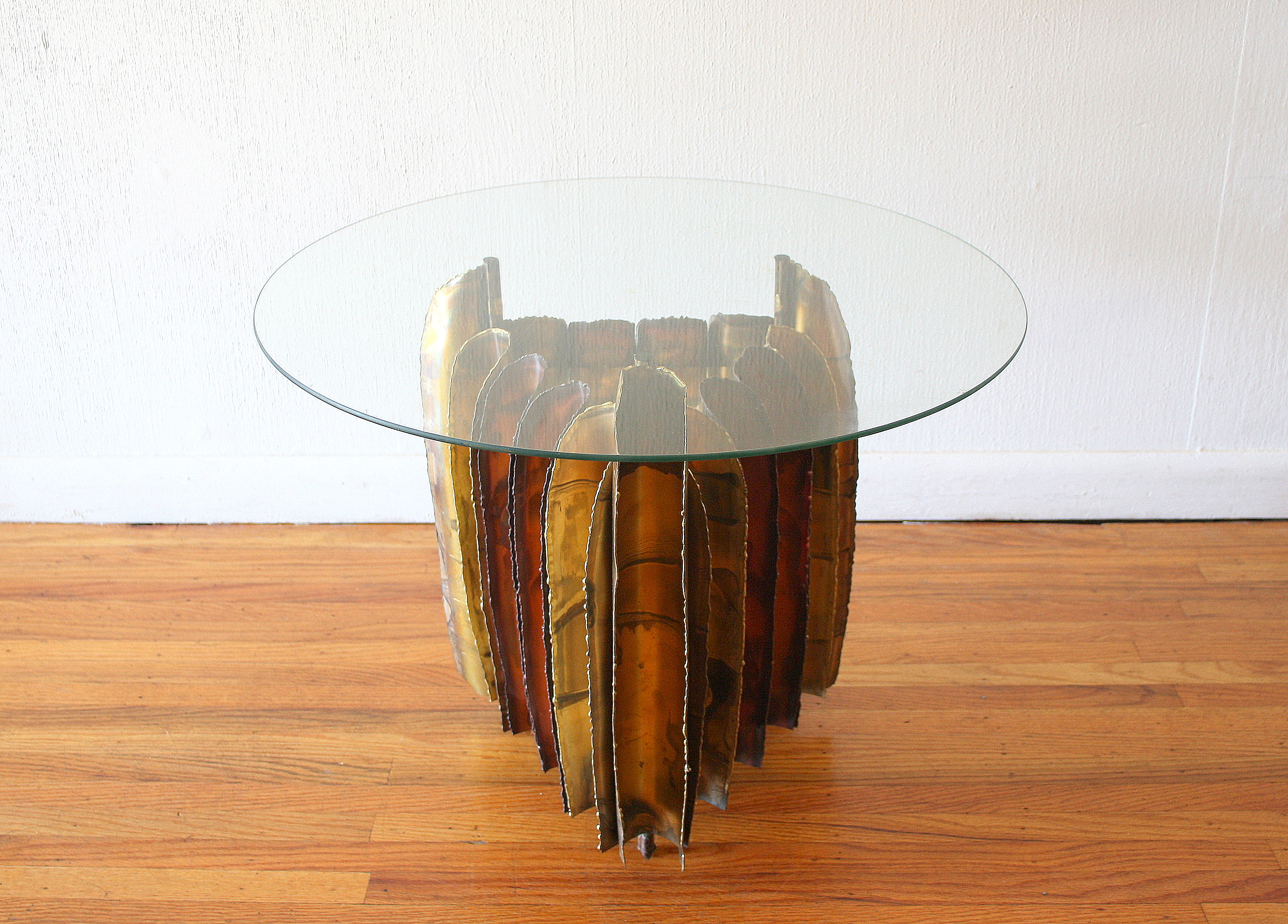 Mcm Brutalist round glass topped table 1